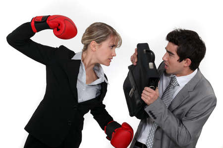 Businesswoman and businessman fighting photo