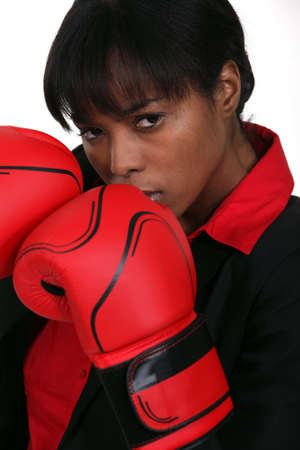 Furious businesswoman boxing photo