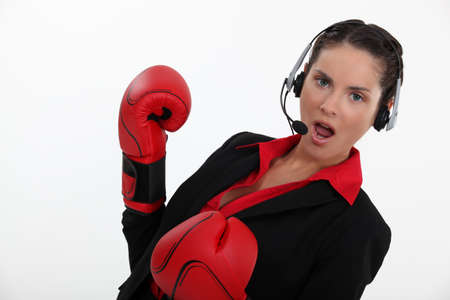 Woman with boxing gloves and helmet Stock Photo - 15718179