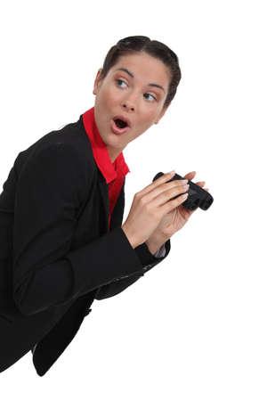scandalous: Shocked woman with a pair of binoculars