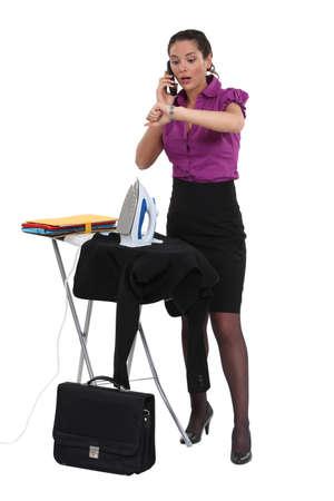 working late: Businesswoman ironing
