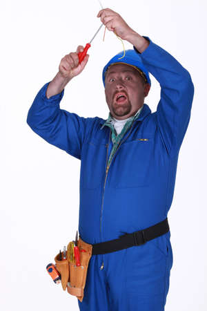 conductive: Electrician getting a shock Stock Photo