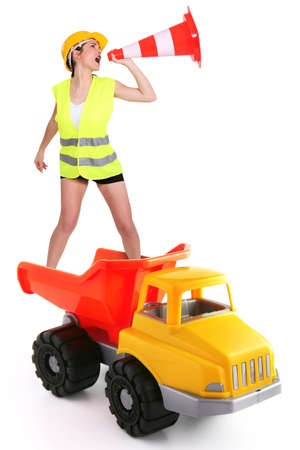 Female traffic guard yelling into a traffic cone and riding a truck photo