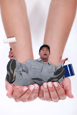 photomontage: Photomontage of a man falling in hands of a woman Stock Photo