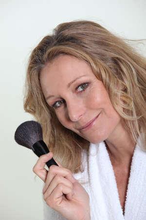blusher: Woman holding blusher brush
