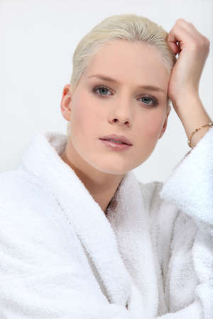 toweling: Stunning blonde woman in full make up and a toweling robe