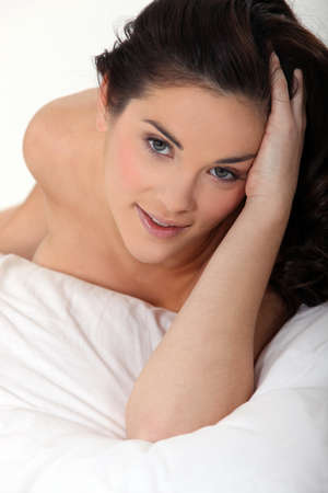 brunette naked: Brunette woman lying in bed