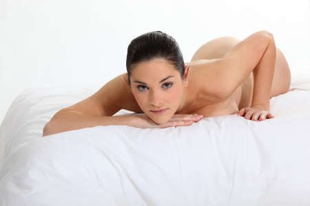 Portrait of a nude woman lying on a bed Stock Photo - 15718252