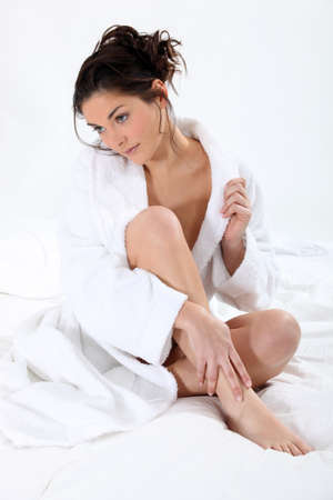Portrait of a sexy woman wearing a bathrobe Stock Photo - 15718425