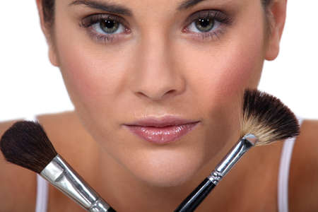 Woman holding her make-up brushes photo