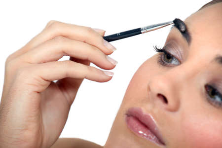 snotty: Woman applying make-up
