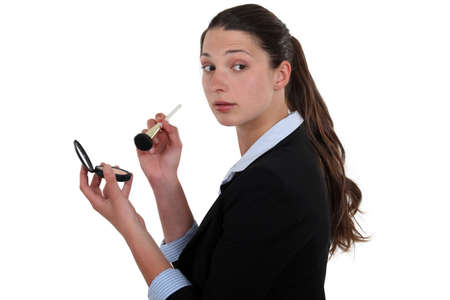 secretly: Businesswoman putting on makeup Stock Photo