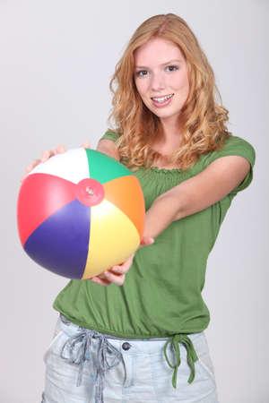 Teenage girl with inflatable beach ball photo
