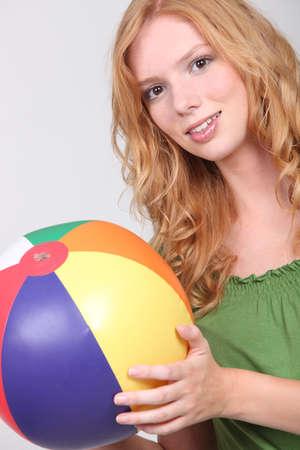beach ball girl: Pretty girl with a beach ball  Stock Photo