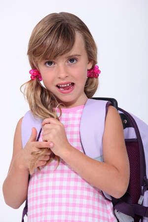 Young schoolgirl with a rucksack photo