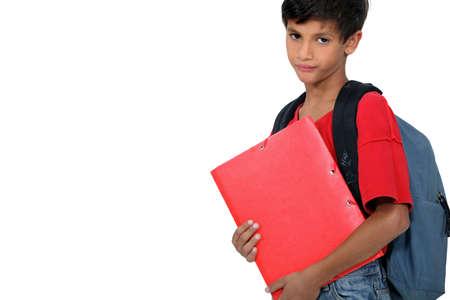 cabizbajo: Chico infeliz en el primer día de escuela Foto de archivo