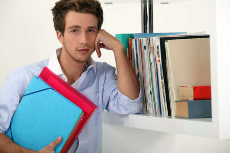 Office worker posing with his files photo