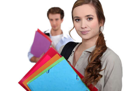 faculty: Students carrying folders