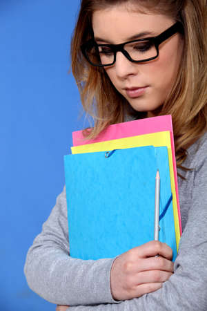 Young student carrying files Stock Photo - 15718539