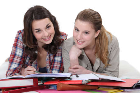 revising: Two female students revising together