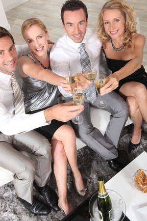 Two young couples with champagne flutes photo
