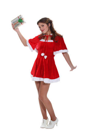 holding aloft: Sexy Miss Santa holding aloft a silver wrapped gift