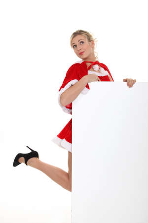 hankering: sexy lady Christmas holding a white panel Stock Photo