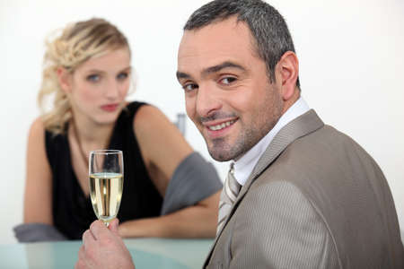 happy rich woman: Couple with champagne Stock Photo