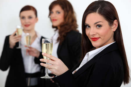 Women toasting with champagne photo