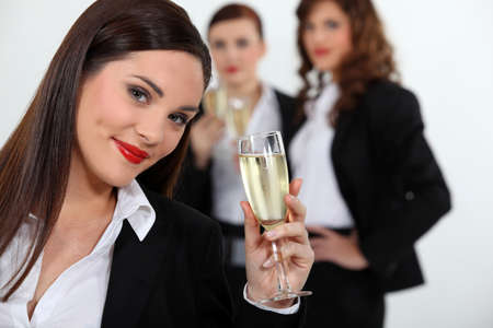 Three successful businessman drinking champagne together photo