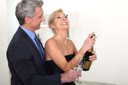Senior couple drinking champagne Stock Photo - 15718358