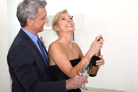 Senior couple drinking champagne Stock Photo - 15718358