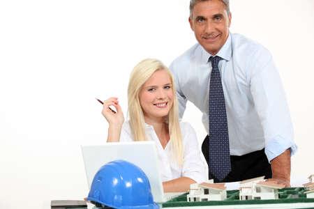 Architects stood by model housing photo
