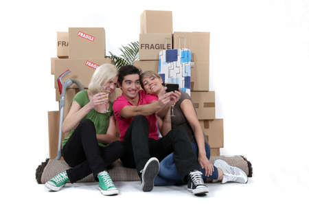 lodging: Friends marking their first day as flatmates Stock Photo