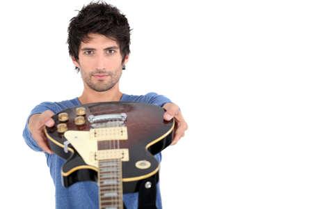 a guitarist boy playing guitar: Man with an electric guitar Stock Photo