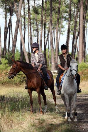 horseback riding: man and woman riding horses Stock Photo