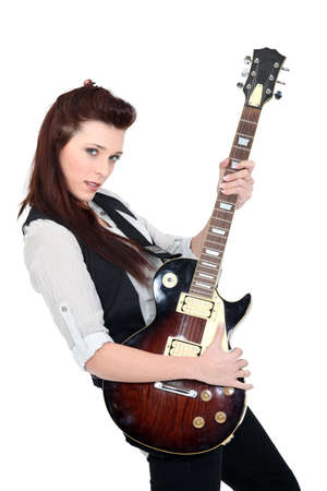 Woman holding an electric guitar Stock Photo - 15718237