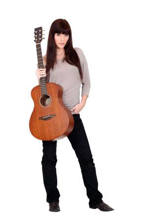 woman guitar: female artist posing with guitar