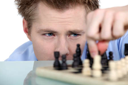 Man moving chess piece Stock Photo - 15718430