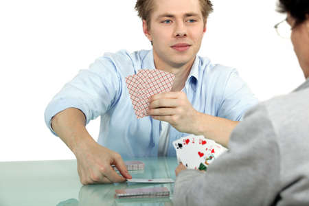 goofing: male colleagues playing cards Stock Photo