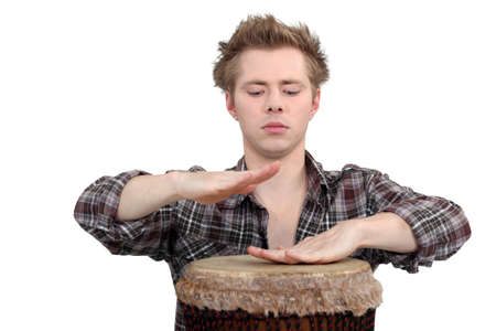 percussionist: Man playing the bongos