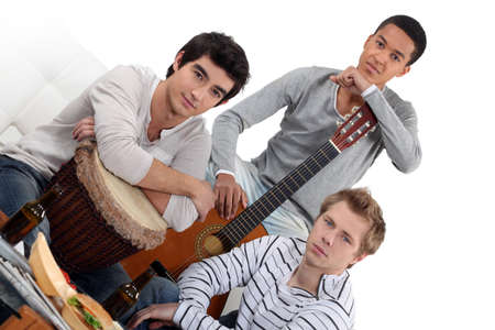 jamming: Young men jamming with instruments