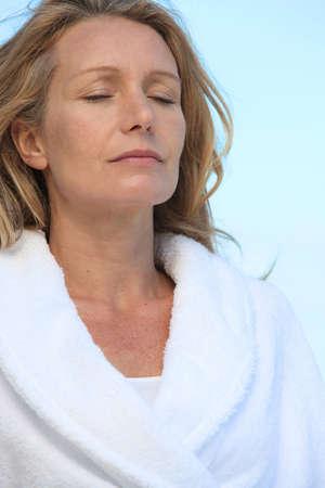 'eyes shut: Mature woman relaxing