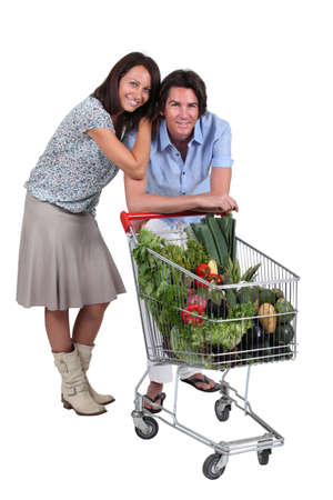 accomplices: portrait of a couple with shopping cart Stock Photo
