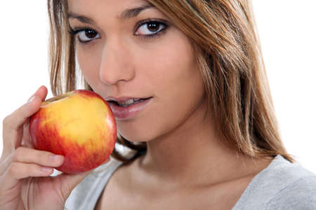 hedonistic: young sensual woman is going to eat an apple Stock Photo