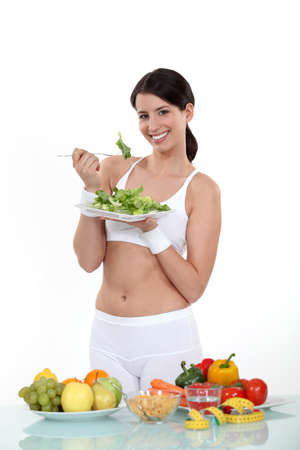 Woman eating healthy food Stock Photo - 15792997