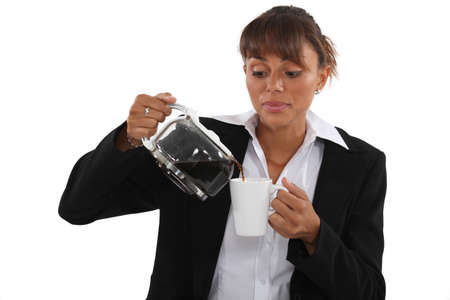gulp: Woman pour coffee into mug Stock Photo