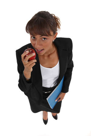 Businesswoman eating an apple photo