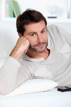 Man sitting on sofa photo