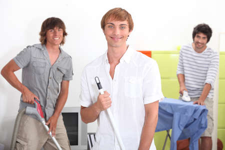 Young men doing household chores photo